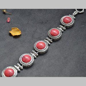 Mooie luxe stalen armband met rode steentjes