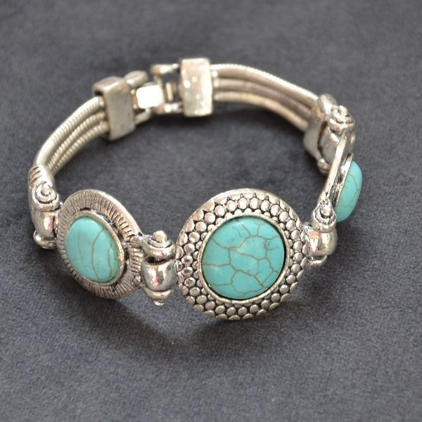 1017 – Hippe turquoise armband met hoge kwaliteit stalen band en leuke stenen