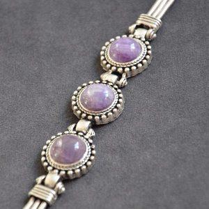 Mooie luxe stalen armband met paarse stenen