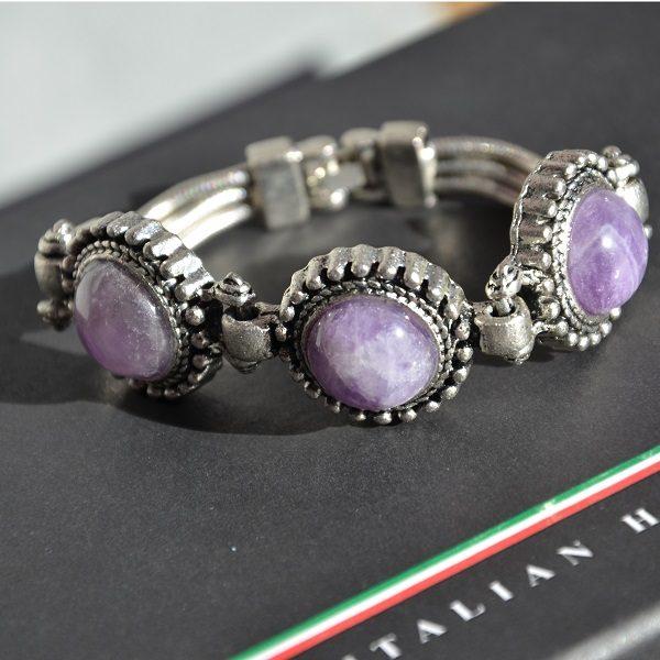 1018 Mooie luxe stalen armband met paarse stenen
