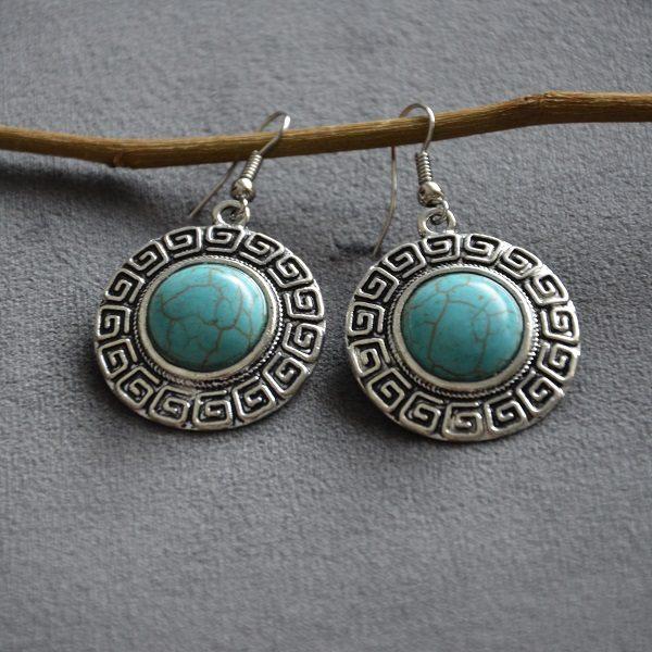 2007 Ronde oorbellen met turquoise steen met klassiek oud romeins patroon