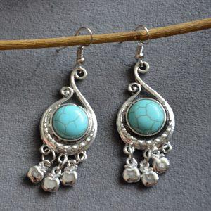 Luxe oorbellen met turquoise steen