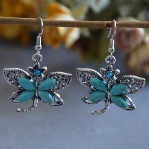 Turquoise oorhangers in de vorm van vlinders met steentje