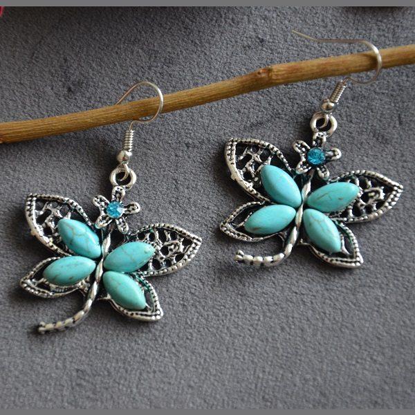 2010 Turquoise oorhangers in de vorm van vlinders met steentje