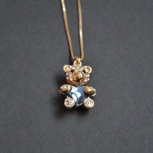 Goudkleurige ketting teddybeer met hartje en kristalletjes